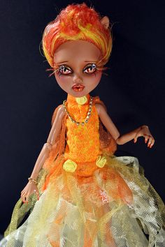 Orange Smoothie is a one-of-a-kind Monster High Howleen doll repaint.  She had her hair trimmed down, a full removal of all factory paint &