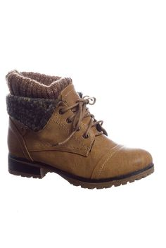 With a rugged tread an attached tan sweater cuff and an outer fold down at the ankle these tan brown or black faux leather lace up boots will get you through slippery weather in style