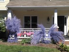 Tie up and spray paint your landscaping grasses and you can have minions in your front yard, just in time for Halloween! www.TheKimSixFix.com