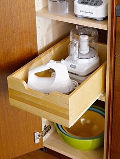Small appliance storage:  Stash small appliances, such as a mixer, food processor, and blender, in a cabinet close to the point of use. Pullout shelves make storage accessible. To prevent accidents or back strain, avoid storing heavy items such as mixers on a shelf above your head or on the bottom shelf of a cabinet. Plan for adequate counter space and convenient electrical plugs at the food-prep area.
