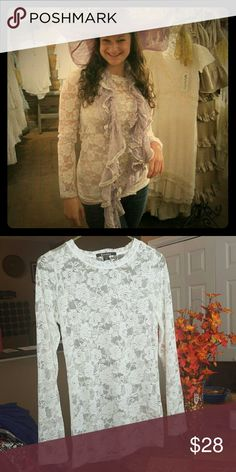 Beautiful White Lace Long-sleeve blouse This timeless piece is so beautiful and elegant. It is very lightweight and see-through, so it goes well with a layer worn underneath. It has a beautiful pattern of rose-like flowers all over it. It is a large, but more on the tight side, closer to a medium, especially if you have a larger bust. It has never been worn and is in excellent condition. :) Bozzolo Tops Blouses