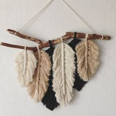 Fine small Wall Hanging in the form of Bird feathers. Made of cotton rope in three colors: unbleached cotton, black and Fine small Wall Hanging in the form of Bird feathers. Made of cotton rope in three colors: unbleached cotton, black and Macrame Wall Hanging Patterns, Macrame Art, Macrame Design, Macrame Projects, Macrame Patterns, Macrame Mirror, Quilt Patterns, Sewing Projects, Yarn Wall Art
