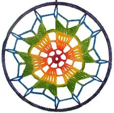 This colourful Rainbow, medium size, handmade, hand-painted Mandala dreamcatcher has been Crocheted onto a solid metal ring frame. A metal swivel cam ensures the dreamcatcher Mandala rotates freely… Size: Diameter: 25.5 cm (10) Length: from hanging loop to bottom of ring: 34.5 cm (13