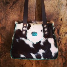 The Bonnie Bag. Laced in turquoise suede and accented with a turquoise stone. From gowestdesigns.us