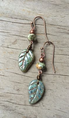 Small Czech glass leaves with faceted rainforest jasper and antiqued copper. Approx 1.5 in length.