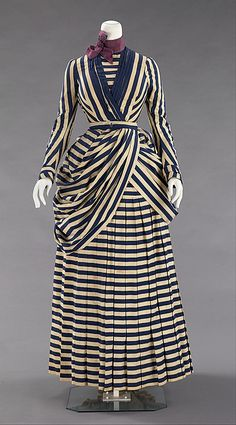 "1885-1888: ""Clothing requirements for most sporting remained strict towards retaining foundation garments such as corsets and bustle, which were thought to stabilize women's frail and weak forms. This example would have been worn for tennis, yachting or general seaside walking. This is a striking example of this type of dress, which is fairly rare in museum collections."""