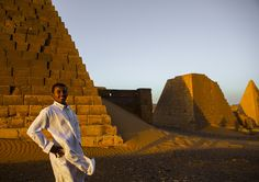 https://flic.kr/p/ecg372 | Young Sudanese Man In Front Of The Pyramids And Tombs In Royal Cemetery, Meroe, Sudan | © Eric Lafforgue www.ericlafforgue.com