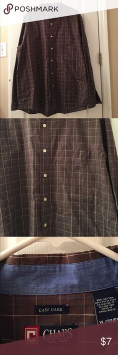 Chaps Easy Care Button Down Shirt - Size XLarge Shirt is brown. It has white, baby blue and navy stripes. Shirt is long Sleeved and in great condition. Has a front pocket. All items have been pre owned, lightly used, NWOT or NWT. They come from a smoke free home. I can not promise items are in perfect condition but they have been cared for extremely well. If there are issues please read the description and look at the images posted. If you have questions please ask. Thank you! Chaps Shirts…