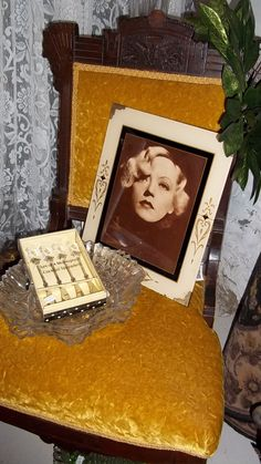One of a pair of Eastlake style chairs with early photo of Marlena Dietrich in art nouveau frame.