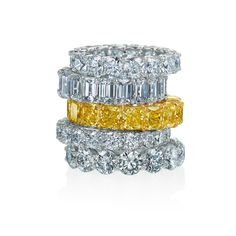Natural yellow and white diamond wedding bands in platinum and yellow gold.