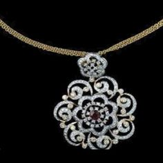 Gold and Diamond jewellery designs: tanishq designer diamond pendant