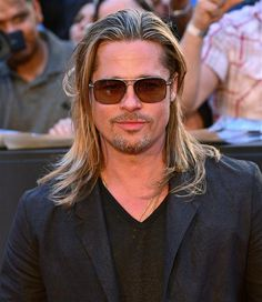 Now that Brad Pitt has chopped off his locks, let's all take a moment to reflect on the sexiness that was Brad's more free-spirited and youthful look.