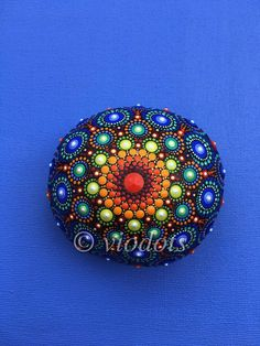The stone has been created with acrylic paint and protected with matt varnish.  The size of the stone is about 8 cm x 7,5 cm x 4,5 cm.  Please contact me if you have any questions.  The stone is ready to ship within 1 - 3 business days using DHL with a tracking number.  If you do not see your