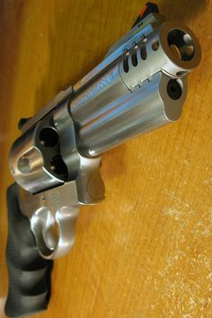 """S & W 500."" - it will take down the big 5 in African game hunting ~;^/>"