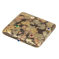 Oxidized Steel, Samorodok Gold, Diamond and Colored Stone Case. The rectangular oxidized steel case applied with samorodok yellow and rose gold, accented by one collet-set old-mine cut diamond and a collet-set round ruby, sapphire and emerald, with oval cabochon sapphire thumbpiece.