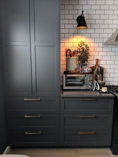 Nothing grounds a kitchen more effectively than bold dark grey paint!
