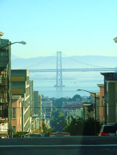 Looking down the street you can catch a view of the Golden Gate Bridge. San Francisco.