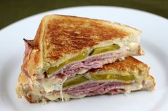 Nice twist on a cuban sandwich. --Ingredients:  8 slices French bread  4 slices deli ham  4 slices deli turkey  8 slices Swiss cheese  8 dill pickle slices  mustard (or mayonnaise)  6 tablespoons butter    Cooking Instructions: