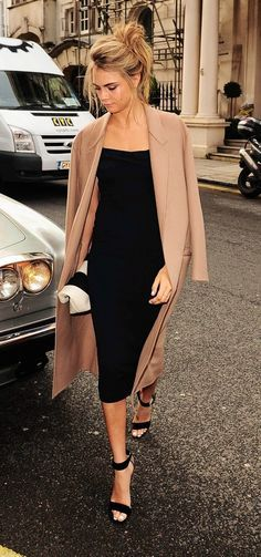 Cara Delevingne street style - tight black midi dress and long tan trench - celebrity fashion