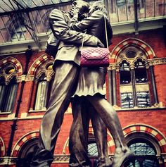 An amazing gigantic sculpture of a farewell embrace decorates the upper platform of London's St. Pancras station.