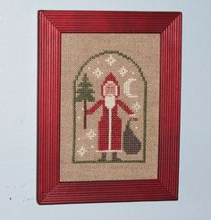 Small cross stitch picture of Santa.  Design by The Prairie Schooler.