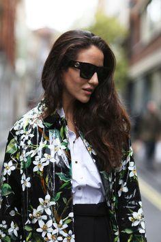 Tamara Kalinic wears a Dolce and Gabbana coat, a Reiss shirt, a Kenzo skirt with Gucci sunglasses.
