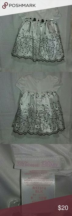 NWT Baby Girl Formal Dress - 12 Months Best Offers Welcomed! Underneath skirt portion is half nylon netting. New with tags. Here is the info from the tag:  Bodice: 100% Polyester Skirt: 54% Nylon  46% Polyester  Lining/Netting: 100% Polyester Bonnie Baby Dresses Formal