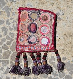 Kinship Stories: Tribal art brooch created with vintage Indian fabric from the Banjara tribe. The tassels are Uzbek and come from an old vintage rug. This brooch is entirely handmade and is a unique piece.