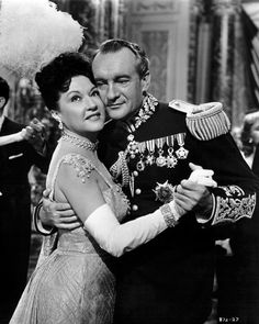 "Ethel Merman and George Saunders in ""Call Me Madam"" (1953). Jewelry and medals by Joseff of Hollywood"