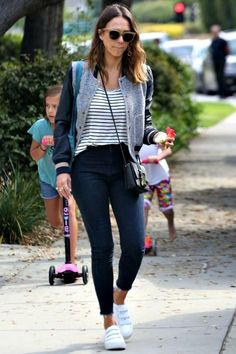 Jessica Alba wearing Christopher Kane Safety Buckle Crossbody Bag and Kenneth Cole Kingvel Velcro Strap Sneakers in White