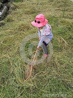 Girl with hayfork