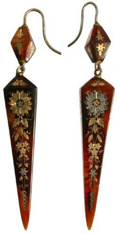 Victorian piqué; a pair of tortoiseshell earrings of square tapering form with silver and gold foliate decoration, 2.5in long;