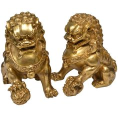 A Pair of Fine Cast Gilt Bronze Figures of The Foo Lions, circa 1930 | From a unique collection of antique and modern metalwork at http://www.1stdibs.com/furniture/asian-art-furniture/metalwork/