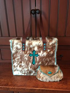 A Market Tote with chocolate brown and turquoise cross, and matching cosmetic bag. From gowestdesigns.us