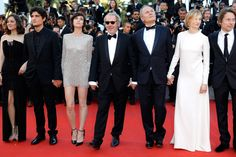 """(L-R) Marion Cotillard, Louis Garrel, Charlotte Gainsbourg, Hippolyte Girardot, director Arnaud Desplechin, Alba Rohrwacher and Mathieu Amalric attend the """"Ismael's Ghosts (Les Fantomes d'Ismael)"""" screening and Opening Gala during the 70th annual Cannes Film Festival at Palais des Festivals on May 17, 2017 in Cannes, France."""