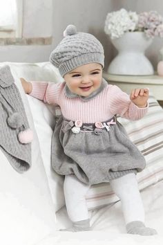 Adorable hand knit toddler dress. Love the muted soft colors.  Classic.