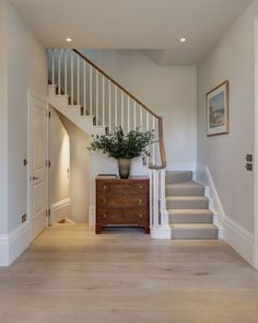 Beautiful soft tones of white, bone, honey and pale stone in this contemporary London home … especially love the kitchen with its wide-planked wood floors, striking marble island and counters, plus th Design Entrée, House Design, Interior Design, Interior Architecture, Style At Home, Hallway Inspiration, Hallway Ideas, Hallway Pictures, Wooden Stairs