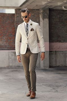 Mens Fashion - Persol Sunglasses, creme blazer, blue striped shirt, tartan tie, green lapel flower, brown pocket square, silver tie clip, olive chinos, tan shoes