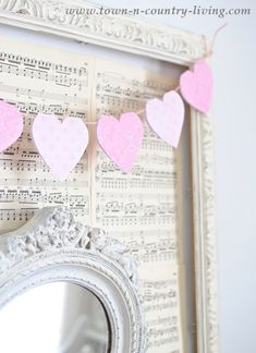 In less than an hour you can make a pretty paper heart banner for Valentine's Day. A free printable is included with step-by-step instructions.