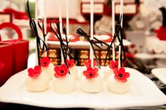 Red Poppy cake pops with thin ribbon bows