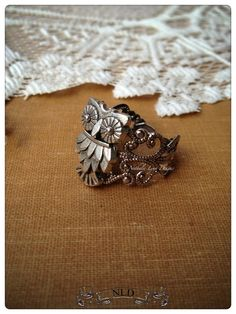 A fun and quirky ring! This is a darling ring you are sure to wear over and over. The filigree ring base in antique silver colored and