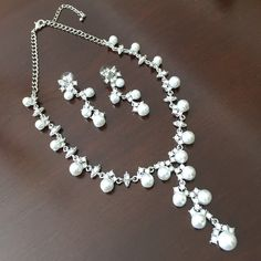 """Necklace Set 16""""L necklace with 3""""L droop """"Y"""" shape paved with Crystals, multi sized white Pearls and 2.25""""L pierced (post) earrings. 3""""L extender chain attached to necklace for ease of use. Jewelry Necklaces"""