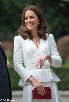 No one will be surprised to read the Duchess opted for a design by Alexander McQueen, the brand's Peplum Coat.