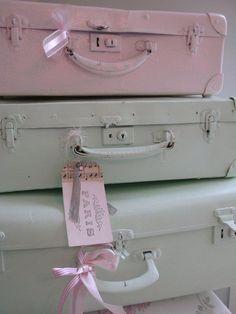 Spray paint pastel colors onto vintage suitcases.