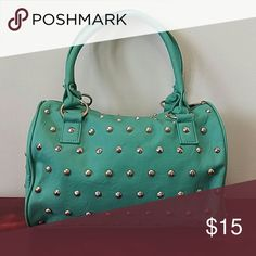 (NOT URBAN OUTFITTERS) Turquoise studded purse NOT Urban Outfitters!! categorized for exposure. Turquoise silver studded purse. Like new, no stains, no damage. Urban Outfitters Bags Shoulder Bags