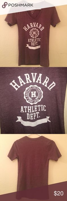 Harvard Athletic Dept. Original League Collegiate Harvard University Athletic Department Original League Collegiate Wear. Official College Sports Athletic Team T-Shirt. This tee is school colors Crimson & white. Maroon burgundy wine red color. So cute & Ivy League chic 🎓🙋Worn & washed twice. Perfect like new condition. So cool! Size small. Fitted true to size. Officially licensed collegiate product. Extremely soft, Lightweight super soft tri-blend. V-neck, Rib-knit collar, Distressed…