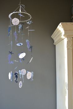 Nursery mobile / baby mobile made with dark blue, white, pastel blue and lilac seahorses, sand dollars and sea stars - Nautical baby shower door SierGoed op Etsy