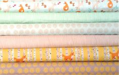 This has fun and playful designs of foxes, deers and nature; in palette of mint, gray, yellow and orange. Textile Co: Riley Blake Designer: Marin Sutton Collection: Good Natured Freshly cut from the bolt. Includes a 1/2 yard each of the following: 1. Natured Main ( deer and fox) in mint 2. Friends (fox) in yellow 3. Fireflies ( circles) in gray 4. Fireflies ( circles) in mint 5. Timber in mint 6. Timber in brown  A total of six cuts, about 3 yards of material. Metric conversion: 0.5 yard…