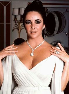 Elizabeth Taylor wearing the 69.42 carat Taylor-Burton diamond given to her by Richard Burton in 1974 and the 33.19 carat Krupp diamond ring, also a gift from Burton.
