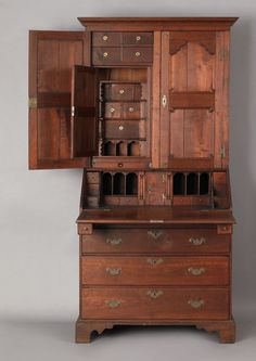 Price:   49,140  Pennsylvania Queen Anne walnut secretary, ca. 1740, probably Chester County, the molded cornice over 2 scalloped panel doors enclosing elaborately fitted interiors with multiple valuables drawers and scalloped pigeon holes and secret compartments, above a fall front desk and 4 drawers supported by bracket feet, 85 h., 39 w.    ~♥~
